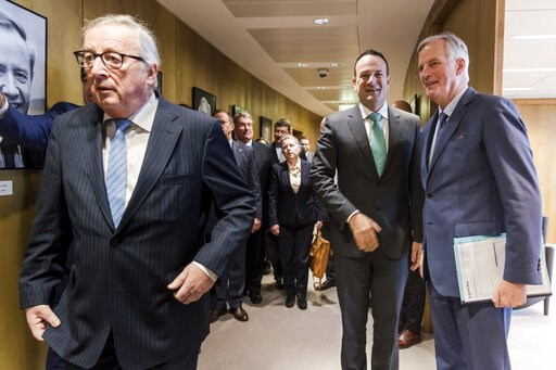 (AP Photo/Geert Vanden Wijngaert, pool). Irish Prime Minister Leo Varadkar, center, greets European Union chief Brexit negotiator Michel Barnier, right, as European Commission President Jean-Claude Juncker, left, walks by before their meeting at the Eu...