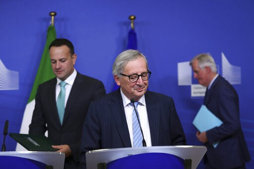 (AP Photo/Francisco Seco). Irish Prime Minister Leo Varadkar, left, European Commission President Jean-Claude Juncker, centre, and European Union chief Brexit negotiator Michel Barnier, background right, arrive for a news conference at the European Com...