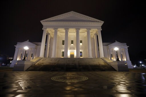 (AP Photo/Steve Helber). The State Capitol is illuminated in Richmond, Va., Wednesday, Feb. 6, 2019. Three of the top elected Democrats in the state are embroiled in controversy.