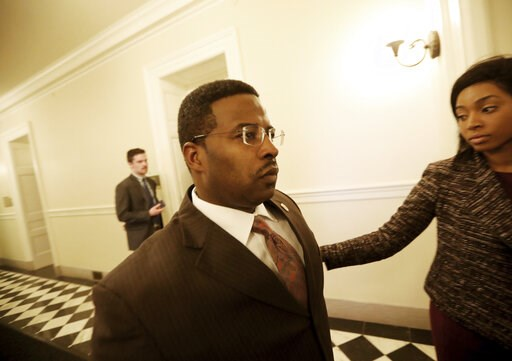 (Steve Earley/The Virginian-Pilot via AP). Del. C.E. Cliff Hayes, Jr., D-Chesapeake, leaves the Democratic Caucus meeting Wednesday, Feb. 6, 2019, in Richmond, Va., after learning on that Virginia Attorney General Mark Herring admitted to wearing a bla...