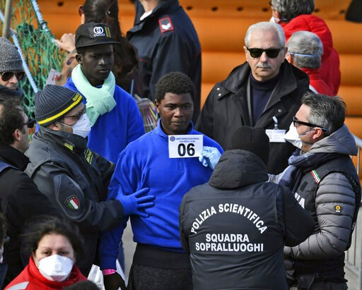 (AP Photo/Salvatore Cavalli). Migrants are photographed for identification as they disembark from the rescue ship Sea-Watch 3, which was carrying 47 migrants, as it docked at the Sicilian port of Catania, southern Italy, Thursday, Jan. 31, 2019. Europe...
