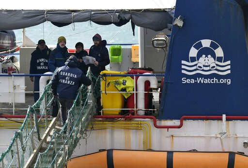 (AP Photo/Salvatore Cavalli, file). FILE - In this Jan. 31, 2019 file photo, Italian Finance Police board the rescue ship Sea-Watch 3 after it disembarked 47 migrants at the Sicilian port of Catania, southern Italy. The Coast Guard said in a statement ...