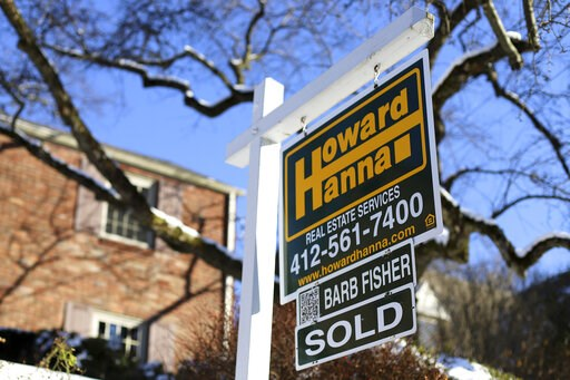 (AP Photo/Gene J. Puskar, File). FILE- In this Jan. 14, 2019, file photo a sold sign outside a home in Mt. Lebanon, Pa. On Thursday, Feb. 7, Freddie Mac reports on this week's average U.S. mortgage rates.