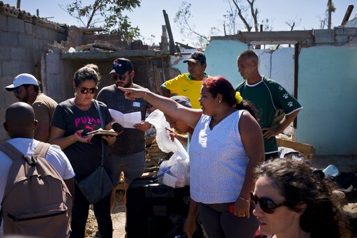 (AP Photo/Ramon Espinosa). Volunteers distribute donations to those affected by last week's tornado in El Roble, on the outskirts of Havana, Cuba, Wednesday, Feb. 6, 2019. More than a week after a rare tornado struck Havana, the worst-hit neighborhoods...