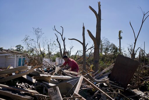 (AP Photo/Ramon Espinosa). A man culls through the debris of a home destroyed by last week's tornado in El Roble, on the outskirts of Havana, Cuba, Wednesday, Feb. 6, 2019. Private aid started almost immediately after the Category F4 tornado struck on ...