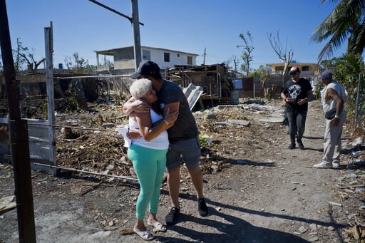 (AP Photo/Ramon Espinosa). A woman affected by last week's tornado receives a hug from a volunteer who is helping distribute donated items in El Roble, on the outskirts of Havana, Cuba, Wednesday, Feb. 6, 2019. In some areas, individuals began arriving...