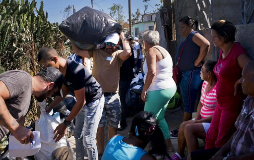 (AP Photo/Ramon Espinosa). Volunteers distribute donations to victims of last week's tornado in El Roble, on the outskirts of Havana, Cuba, Wednesday, Feb. 6, 2019. Private aid started almost immediately after the Category F4 tornado struck on the nigh...