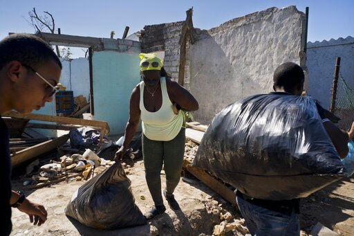(AP Photo/Ramon Espinosa). A woman receives donations in front of home destroyed by last week's tornado in El Roble, on the outskirts of Havana, Cuba, Wednesday, Feb. 6, 2019. For the first time in communist Cuba, prosperous individuals and successful ...