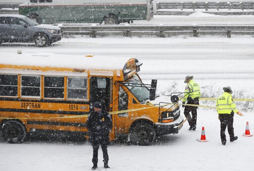 (Richard Tsong-Taatarii/Star Tribune via AP). A person of interest was taken into custody after a school bus driver was shot where Interstate 35W and 94 run together near downtown Minneapolis Tuesday, Feb. 5, 2019.