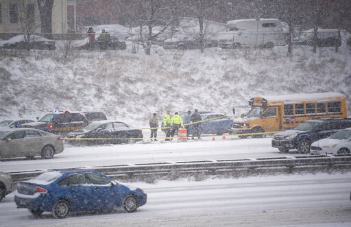 (Jeff Wheeler/Star Tribune via AP). State Highway Patrol investigate the scene of a shooting on I-35W south Tuesday, Feb. 5, 2019, in Minneapolis. Authorities say a school bus driver was wounded in a shooting that followed a crash with another vehicle ...