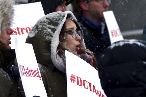 (AP Photo/Thomas Peipert). Denver teacher Rachel Davis protests outside the Colorado State Capitol on Wednesday, Feb. 6, 2019. Teachers said they plan to strike next week after state officials declined to intervene in a pay dispute between the educator...