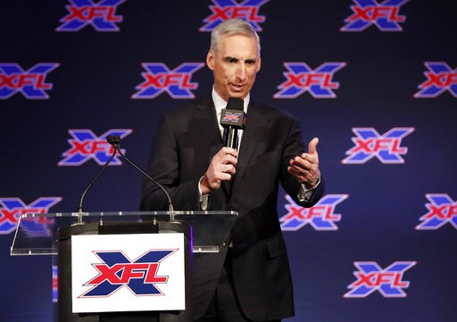 (AP Photo/Tony Gutierrez). Oliver Luck, XFL Commissioner and CEO makes comments during a news conference where he introduced Bob Stoops as the new general manager and head football coach of the Dallas XFL team in Arlington, Texas, Thursday, Feb. 7, 2019.