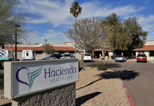 (AP Photo/Matt York, file). FILE - This Jan. 25, 2019, file photo shows the Hacienda HealthCare facility in Phoenix. The long-term care facility in Arizona is shutting down a unit where an incapacitated woman was raped and later gave birth, officials w...