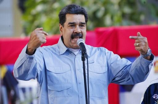 (AP Photo/Ariana Cubillos). Venezuela's President Nicolas Maduro speaks during an event at Bolivar Square in Caracas, Venezuela, Thursday, Feb. 7, 2019. Maduro said that he hopes to collect 10 million signatures demanding that Washington withdraw threa...