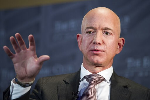 (AP Photo/Cliff Owen, File). FILE- In this Sept. 13, 2018, file photo Jeff Bezos, Amazon founder and CEO, speaks at The Economic Club of Washington's Milestone Celebration in Washington. Bezos says the National Enquirer is threatening to publish nude p...