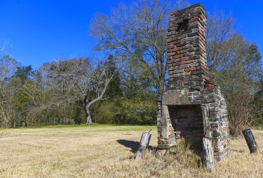 (AP Photo/Julie Bennett). A chimney, the last remaining original structure from the days when survivors of the Clotilda, the last known slave ship brought into the United States, inhabited the area, stands in an abandoned lot in Africatown in Mobile, A...