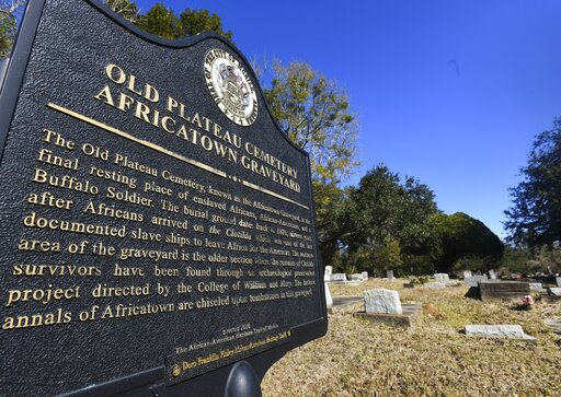 (AP Photo/Julie Bennett). Old Plateau Cemetery, the final resting place for many who spent their lives in Africatown, stands in need of upkeep near Mobile, Ala., on Tuesday, Jan. 29, 2019. Many of the survivors of the Clotilda's voyage are buried here ...