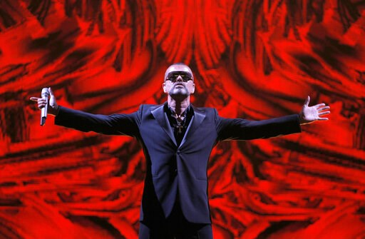 (AP Photo/Francois Mori, File). FILE - In this Sept. 9, 2012 file photo, British singer George Michael performs at a concert to raise money for the AIDS charity Sidaction, during the Symphonica tour at Palais Garnier Opera house in Paris, France. Artwo...