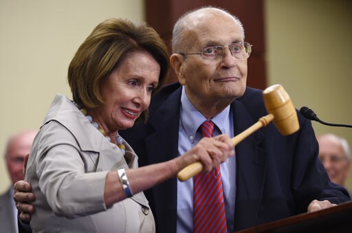 (AP Photo/Susan Walsh, File). FILE - In this July 29, 2015 file photo, House Minority Leader Nancy Pelosi of Calif., standing with former Rep. John Dingell, D-Mich., holds up the gavel Dingell used 50 years ago when Medicare legislation was passed duri...