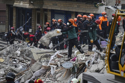 (AP Photo/Emrah Gurel). Rescue workers try to remove rubble from an eight-story building which collapsed a day earlier in Istanbul, Thursday, Feb. 7, 2019. A 5-year-old girl was rescued from the rubble of the eight-story apartment building in Istanbul ...