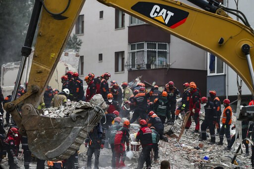 (AP Photo/Emrah Gurel). Rescue workers continue to remove rubble from an eight-story building which collapsed a day earlier in Istanbul, Thursday, Feb. 7, 2019. A 5-year-old girl was rescued from the rubble of the eight-story apartment building in Ista...