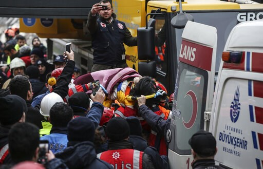 (AP Photo/Emrah Gurel). Rescue workers carry 5-year old girl Havva Tekgoz, after she was pulled from the rubble of an eight-storey building, some 18-hours after it collapsed, in Istanbul, Turkey, Thursday, Feb. 7, 2019. The girl, Havva Tekgoz, was seen...