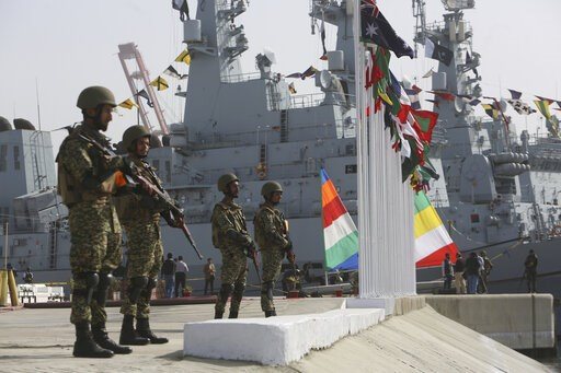 (AP Photo/Fareed Khan). Pakistan personal stand guard during the opening ceremony of Pakistan Navy's Multinational Exercise AMAN-19, in Karachi, Pakistan, Friday, Feb. 8, 2019. A five-day multinational exercise hosted by Pakistan Navy has begun near th...