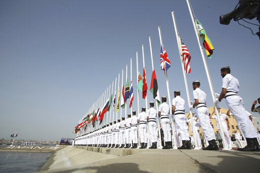 (AP Photo/Fareed Khan). Pakistan Naval personal hoist national flags of participating countries during the opening ceremony of Pakistan Navy's Multinational Exercise AMAN-19, in Karachi, Pakistan, Friday, Feb. 8, 2019. A five-day multinational exercise...