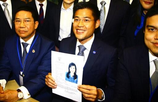 (AP Photo). Leader of Thai Raksa Chart party Preecha Pholphongpanich, center, holds a picture of Princess Ubolratana at election commission of Thailand in Bangkok, Thailand, Friday, Feb. 8, 2019. The political party has selected the princess as its nom...