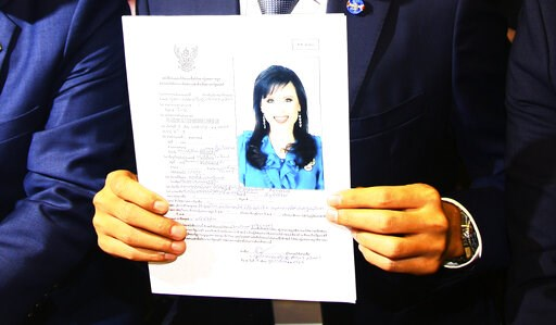 (AP Photo). Leader of Thai Raksa Chart party Preecha Pholphongpanich holds a picture of Princess Ubolratana at election commission of Thailand in Bangkok, Thailand, Friday, Feb. 8, 2019. The political party has selected a princess as its nominee to ser...