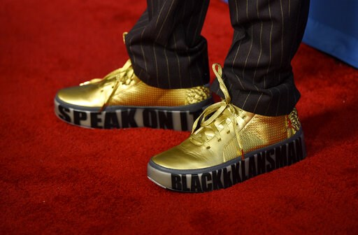 """(Photo by Chris Pizzello/Invision/AP). Spike Lee arrives wearing shoes that read """"BlacKkKlansman"""" and """"Speak On It"""" at the 71st annual DGA Awards at the Ray Dolby Ballroom on Saturday, Feb. 2, 2019, in Los Angeles."""