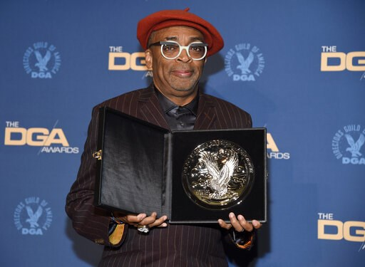 """(Photo by Chris Pizzello/Invision/AP). Spike Lee poses in the press room with a plaque for his nomination for outstanding directorial achievement in feature film for """"BlacKkKlansman"""" at the 71st annual DGA Awards at the Ray Dolby Ballroom on Saturday, ..."""