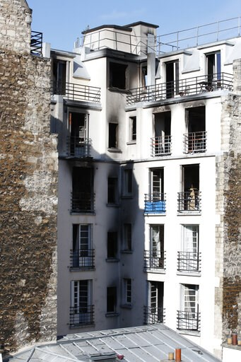 (AP Photo/Christophe Ena). View of the apartment building after a fire broke Tuesday, Feb. 5, 2019 in Paris. Paris' deadliest fire in over a decade claimed 10 lives, sending fleeing residents to the roof to escape the flames that engulfed their apartme...