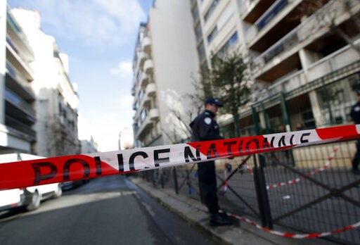 (AP Photo/Christophe Ena). A police office stands guard in the street where a fire broke Tuesday, Feb. 5, 2019 in Paris. Paris' deadliest fire in over a decade claimed 10 lives, sending fleeing residents to the roof to escape the flames that engulfed t...
