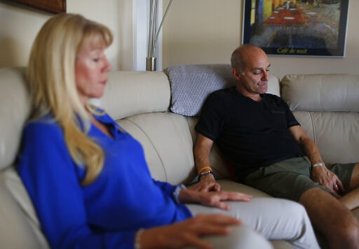(AP Photo/Brynn Anderson). In this Feb. 5, 2019, photo, Mitch and Annika Dworet speak during an Associated Press interview in Coral Springs, Fla. Their oldest son Nick died in the Marjory Stoneman Douglas High School massacre and his brother Alex was w...