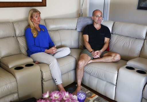 (AP Photo/Brynn Anderson). In this Feb. 5, 2019, Mitch and Annika Dworet speak during an Associated Press interview in Coral Springs, Fla. Their oldest son Nick died in the Marjory Stoneman Douglas High School massacre and his brother Alex was wounded....