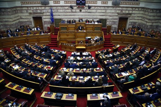(AP Photo/Thanassis Stavrakis). Greece's Prime Minister Alexis Tsipras delivers a speech during a parliament session in Athens, Friday, Feb. 8, 2019. Greek lawmakers are set Friday to approve Macedonia's NATO accession, ending a process to normalize re...