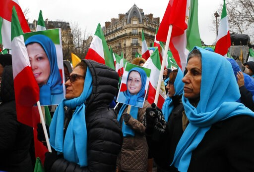 (AP Photo/Francois Mori). Demosntrators carry posters of Maryam Rajavi, the leader of the National Council of Resistance of Iran, during a protest in Paris, Friday Feb.8, 2019 as Iran marks the 40th anniversary of its Islamic Revolution.