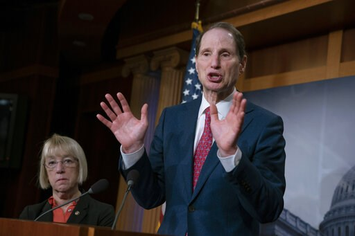 (AP Photo/J. Scott Applewhite, File). FILE - In this Dec. 19, 2018, file photo, Sen. Ron Wyden, D-Ore., joined at left by Sen. Patty Murray, D-Ore., speaks during a news conference to press Congress to intervene on behalf of the Affordable Care Act, af...