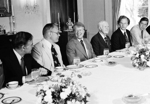 (AP Photo/Charles Harrity, File). FILE - In this June 2, 1977 file photo, President Jimmy Carter hosts a breakfast in the Family Dining Room of the White House in Washington for House Subcommittee members on Energy and Power. From left are Rep. John M....