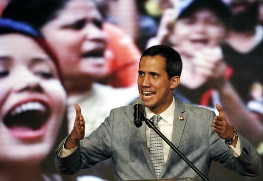 (AP Photo/Ariana Cubillos). Venezuela's self-proclaimed president Juan Guaido speaks during a meeting with university students at the Central University of Venezuela, in Caracas, Venezuela, Friday, Feb. 8, 2019. Guaido declared himself interim presiden...