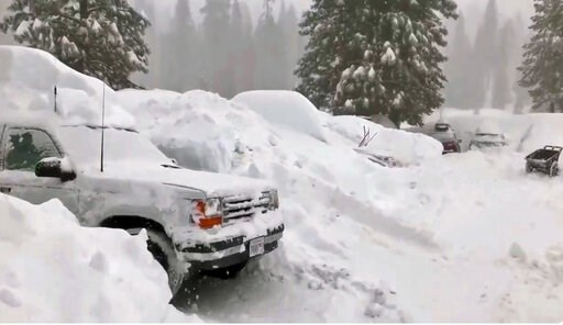 (Joel Keeler via AP). This Tuesday, Feb. 5, 2019 photo from video by Joel Keeler shows vehicles buried in the parking lot of the snowed-in Montecito Sequoia Lodge in Kings Canyon National Park in California's Sierra Nevada. More than 120 visitors and s...