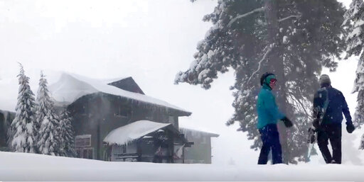 (Joel Keeler via AP). This Tuesday, Feb. 5, 2019 photo from video by Joel Keeler shows people approaching the showed-in Montecito Sequoia Lodge in Kings Canyon National Park in California's Sierra Nevada. More than 120 visitors and staff who became sno...