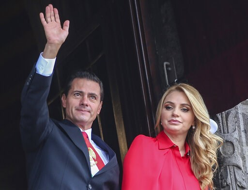 (AP Photo/Anthony Vazquez, File). FILE - In this Sept. 16, 2018 file photo, Mexico's President Enrique Pena Nieto waves from a National Palace balcony, accompanied by first lady Angelica Rivera, during the Independence Day military parade in the Zocalo...