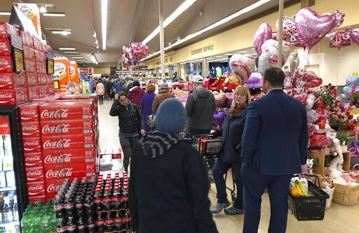 (AP Photo/Ted S. Warren). Shoppers line up to check out with their groceries, Thursday, Feb. 7, 2019, at a Safeway store in Tacoma, Wash. Many were stocking up after officials issued a winter storm warning for the Puget Sound region from noon Friday to...