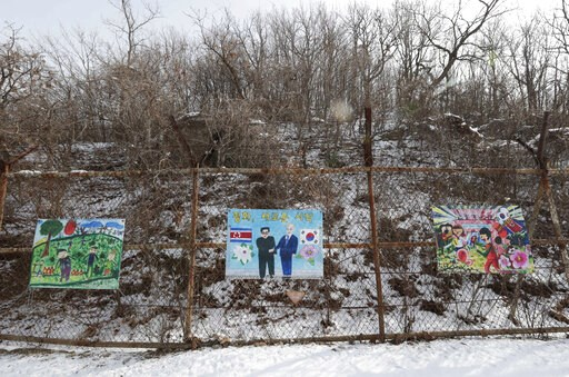 (AP Photo/Lee Jin-man). Paintings wishing peace on the Korean peninsula hang on a fence at the DMZ museum inside a restricted area in Goseong, South Korea, Friday, Feb. 8, 2019. The top U.S. envoy for North Korea returned to South Korea on Friday after...