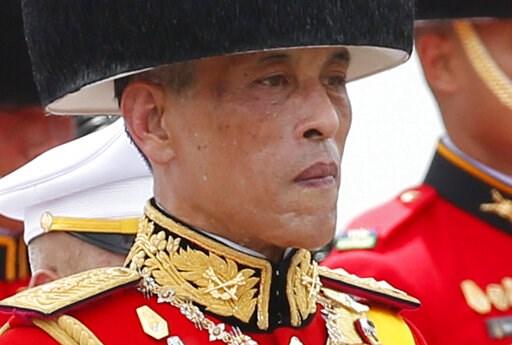 (AP Photo/Sakchai Lalit, File). FILE - In this Oct. 26, 2017, file photo, Thailand's King Maha Vajiralongkorn walks in a funeral procession of his father the late King Bhumibol Adulyadej in Bangkok, Thailand. Late Friday, Feb. 8, 2019, King Vajiralongk...