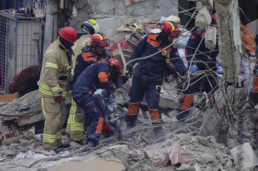 (AP Photo/Emrah Gurel). Rescue workers continue to remove rubble from an eight-story building which collapsed two days earlier in Istanbul, Friday, Feb. 8, 2019. Turkish rescue workers on Friday pulled out a 16-year-old boy from the rubble of an eight-...