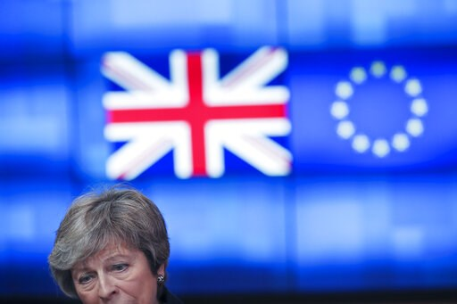 (AP Photo/Francisco Seco). Britain's Prime Minister Theresa May talks to journalists after her meeting with European Council President Donald Tusk at the European Council headquarters in Brussels, Thursday, Feb. 7, 2019.