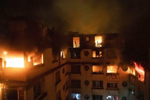 (Benoit Moser/BSPP via AP). In this photo provided on Tuesday, Feb. 5, 2012 by the Brigade de Sapeurs-Pompiers de Paris (Paris Fire Brigade), a fire rages through the top floors of an apartment building in Paris, France. The fire that authorities suspe...